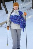 Cross contry skiing with sling and newborn baby Stock Image
