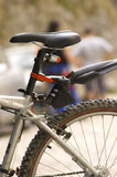 Cross country bicycle detail. Saddle and rear wheel of a cross country bicycle Royalty Free Stock Photo