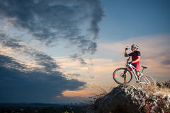 Cross country biker relaxing on the top of the mountain stock images