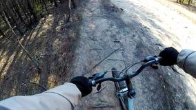 Cross country mountain biking Point Of View POV. POV Mountain Biking Through Forest Real Cam Shot stock footage