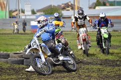 Cross-country race. Motorcyclists on motorcycles enter turn. Royalty Free Stock Photos