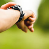 Cross Country Runner Looking At Sport Watch Stock Image