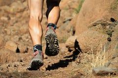 Cross country running feet run through rocky terrain Stock Image