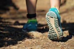 Cross country running feet run through rocky terrain Royalty Free Stock Photography
