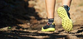 Cross country running feet run through rocky terrain Stock Photo
