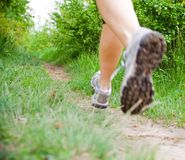 Cross country running woman, sport shoes Royalty Free Stock Photo