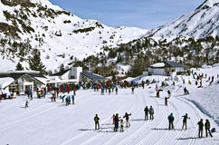 Cross-Country ski resort Somport in French Pyrenees. Somport Cross-Country ski resort in French Pyrenees at Spanish border and numerous skiers. Mountains Royalty Free Stock Image