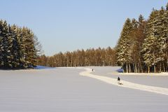 Cross-country ski run in winter through snow-covered countryside, Bavaria, Germany royalty free stock photo