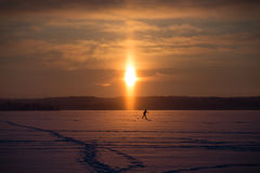Cross-country skier at a frozen lake Stock Images
