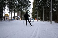 Cross country skier getting ready to continue in bad weather. Cross country skier getting ready to continue in bad weather Stock Photo