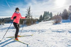 Cross country skier. Woman cross country skiing on a yellow skis Stock Photos