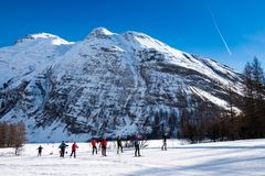 Cross country skiers in Bessans - France Alps royalty free stock image