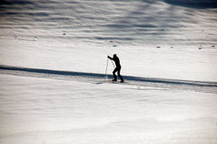 Cross-country skiing. Man making ski-touring Stock Photos