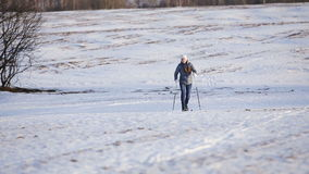 Cross-country skiing on field. stock video footage