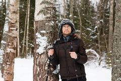 Young man cross-country skiing in the forest. Cross-country skiing: man cross-country skiing in the forest in winter Royalty Free Stock Photography