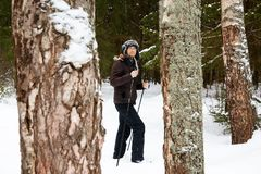 Young man cross-country skiing in the forest. Cross-country skiing: man cross-country skiing in the forest in winter Royalty Free Stock Photos