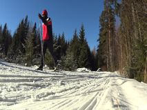 Cross country skiing man passing by stock video footage