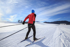 Cross-country skiing. A man cross-country skiing on the trail in Bavaria Royalty Free Stock Images