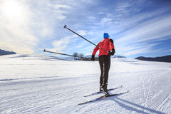 Cross-country skiing. A man cross-country skiing on the trail in Bavaria Royalty Free Stock Photo