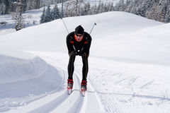 Cross-country skiing on a trail in snowy landscape Stock Images