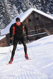 Cross-country skiing on a trail in snowy landscape Royalty Free Stock Images