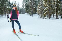 Cross-country skiing woman doing classic nordic cross country Stock Photo