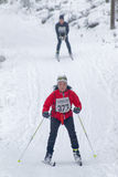 Cross country skiing woman followed by a man Royalty Free Stock Photo