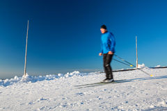 Cross-country skiing: young man cross-country skiing Royalty Free Stock Photos