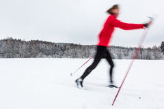Cross-country skiing: young woman cross-country skiing Royalty Free Stock Photos