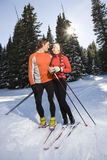 Cross Country Snow Skiiers Smiling at Each Other Royalty Free Stock Photos