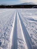 Cross-country tracks in fresh snow stock image