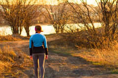 Cross-country trail running people at sunset. Runner couple exercising outside as part of healthy lifestyle. Stock Images