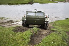 Cross-country vehicle crosses the river Royalty Free Stock Photo