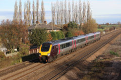 Cross country Voyager train passing Bolton Percy. Royalty Free Stock Photography