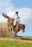 Cross-Country, woman horseback on jumping horse Stock Photos