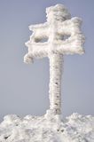 Cross. Cover with snow and ice stock images