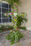Cross Covered In Flowers. Christian cross, covered in spring flowers during Easter celebration Stock Photos