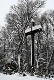 A cross covered with snow at ​​Savonlinna Finland stock photography