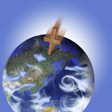 Cross crashing to earth. Picture of a cross crashing into earth Stock Photography