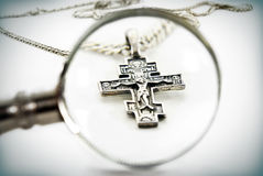 Cross-creed analyzed with a magnifying glass Royalty Free Stock Image