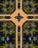 Cross of a cross. Kaleidoscope cross from photo of cross above chapel of Queen of Angels Monastery, Mt. Angel, Oregon; Giant Sequoia tree in background Stock Image