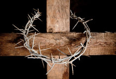 Cross and crown. Crown of thorns hung around the Easter cross Stock Photography