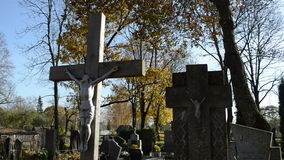 Cross crucified jesus stone monuments rural autumn graveyard stock footage