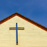 Cross/crucifix atop the front facia of a British Parish Hall Royalty Free Stock Images