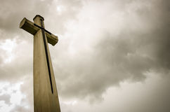 Cross in dark clounds Stock Photo