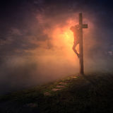 The cross with dark skies. Jesus hanging on the cross with the skies getting dark Royalty Free Stock Photography