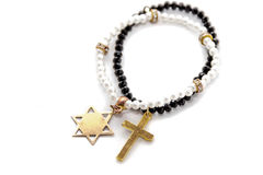 Cross and Davidstern necklaces. Two pearl necklaces, one with the cross, another star of david with the star-six-corners, isolated, white background Stock Photography