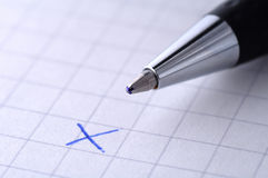 Cross - decline - deny. A close up of a pen with a cross written on paper - see the portfolio for accept symbol stock photo