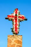 Cross decorated with flowers Royalty Free Stock Image
