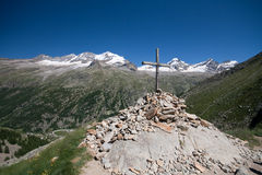 Cross dell'Arolley. Cross of Arolley in Valsavaranche in the Gran Paradiso National Park (Valle d'Aosta). Background is the summit of Gran Paradiso (mt 4061) and Royalty Free Stock Image